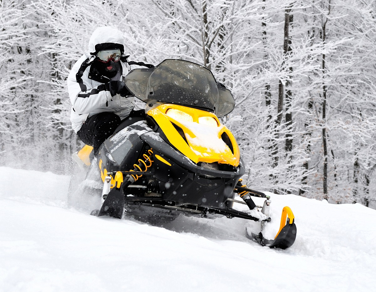 Man driving a snowmobile