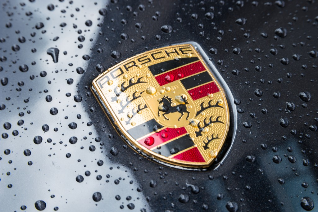 Porsche logo on black car