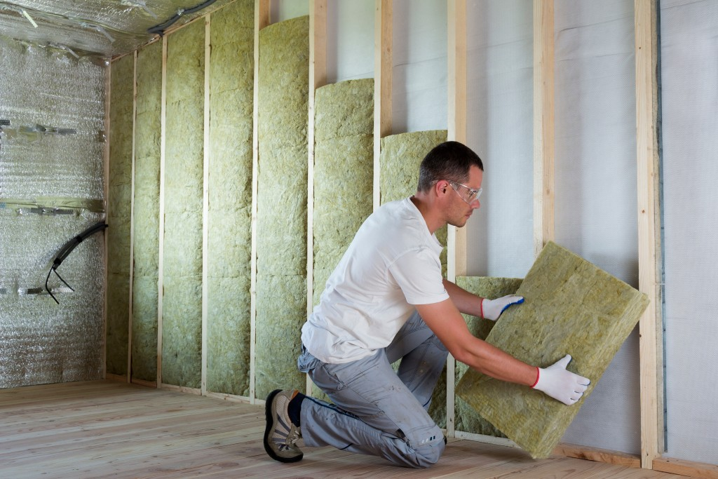 Man installing soundproof wall