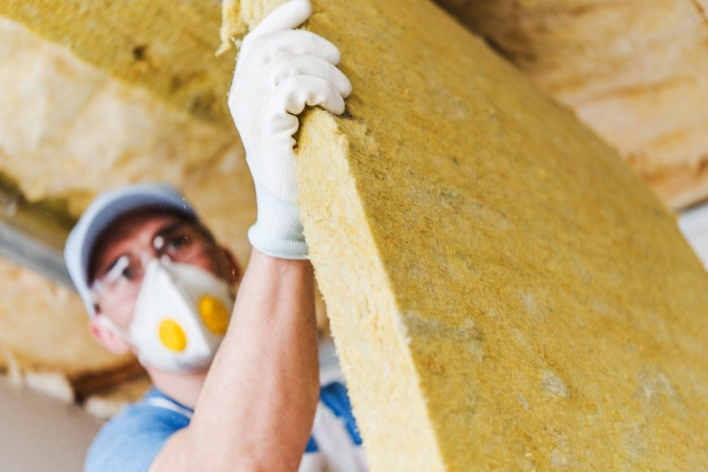 worker installing insulations