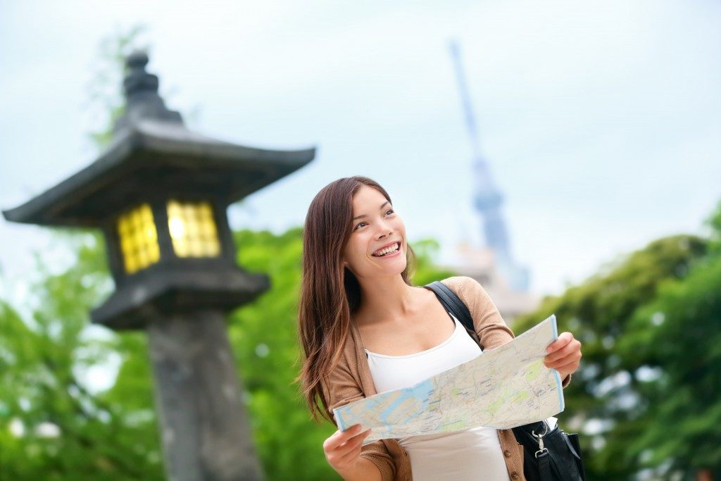Woman traveling alone and looking at map