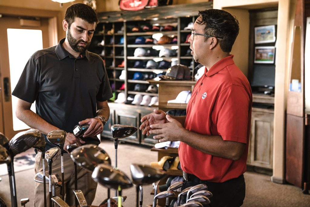 retail salesman assisting a customer