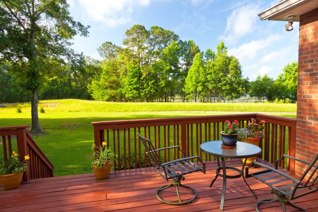 Residential backyard deck overlooking lawn