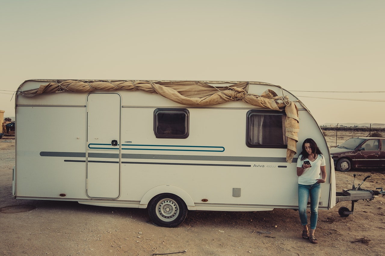 person standing in front of an RV