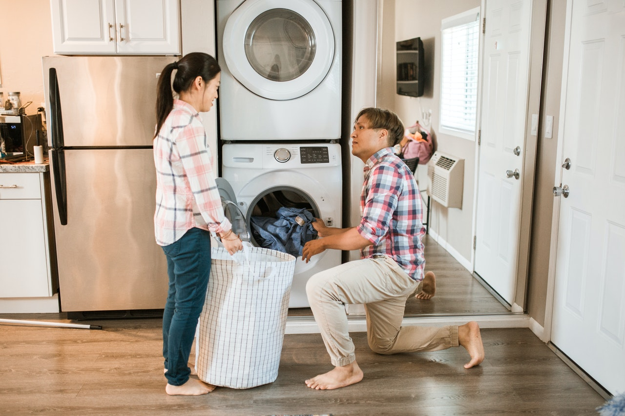 couple in laundry room