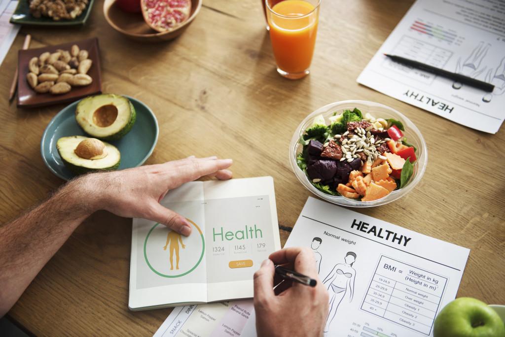 man listing health needs