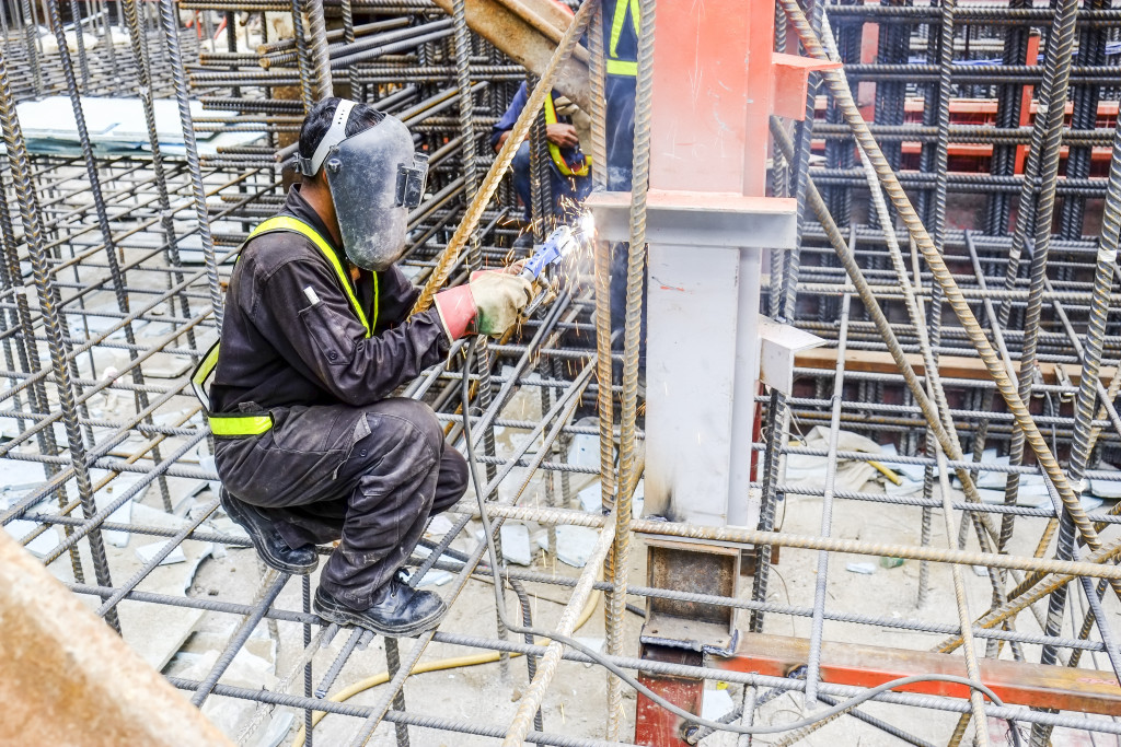 man welding at a construction site