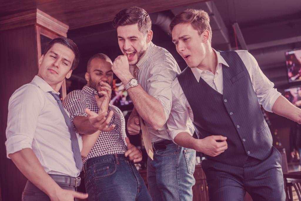 friends doing karaoke